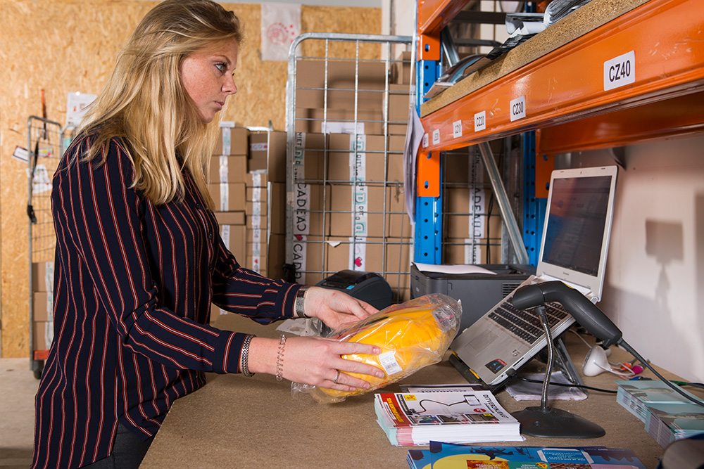 Scanning products at the packing table